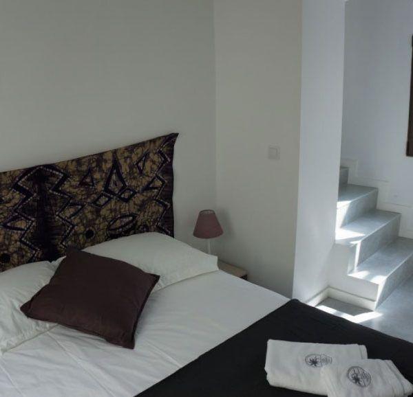 Habitación con doble cama en Tarifa