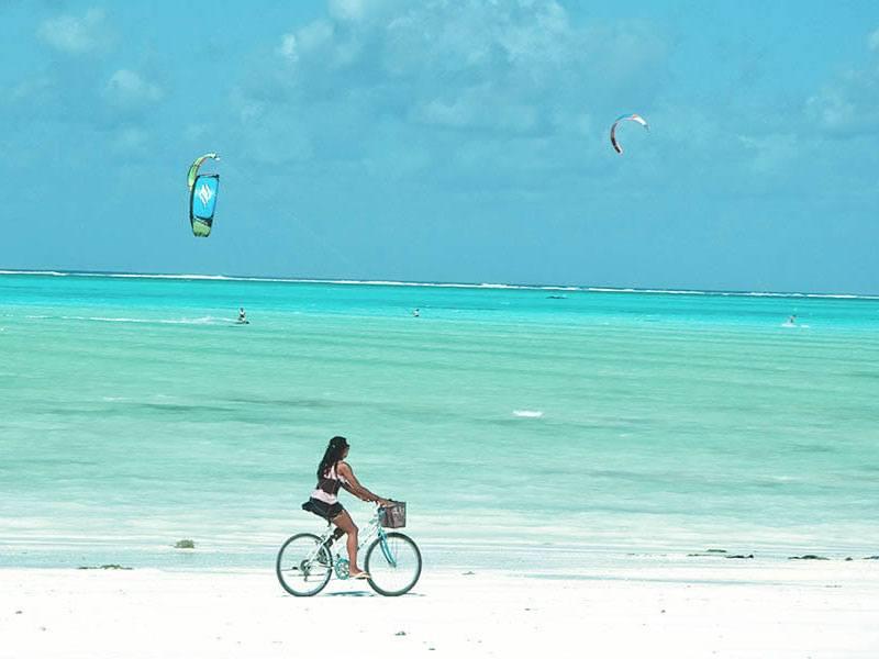 Kitesurfing in turquoise water at Paje beach Zanzibar