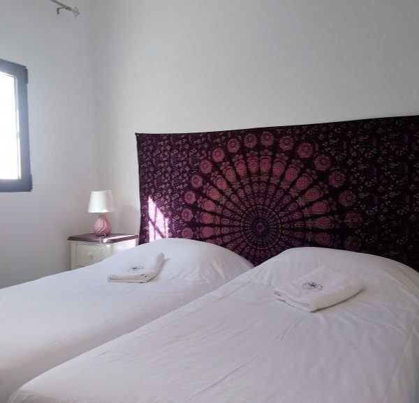 Habitación con dos camas en apartamento en Tarifa