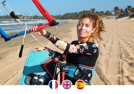Kite girl on the beach ready for kitesurfing