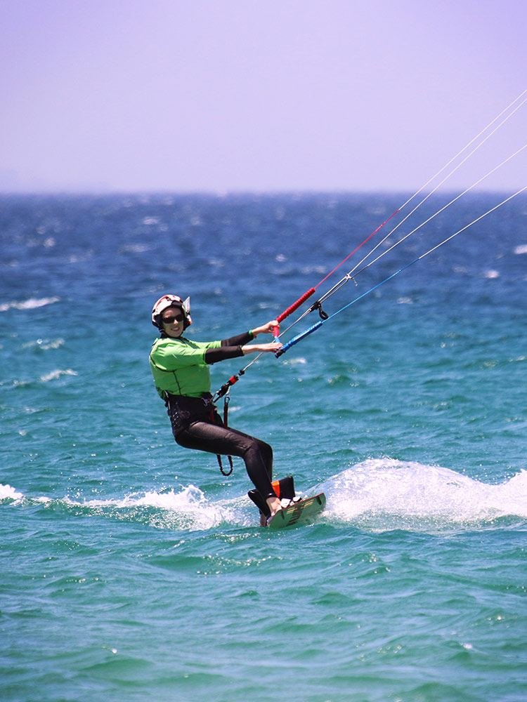 Kitesurf girl riding upwind